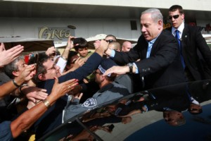 Israel's Prime Minister Benjamin Netanyahu shaking hands with Israeli citizens during a recent visit to the southern city of Ashdod. PHOTO / Yossi Zamir-Flash90