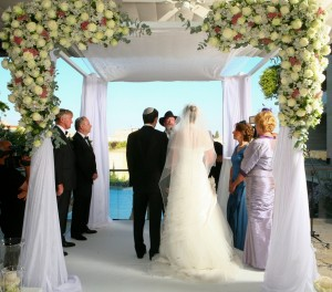 A happy couple stands under a chuppah during a recent wedding in Jerusalem. PHOTO / Fenton