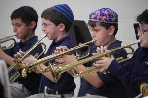 Brass players Roy Ginzberg (L-R), Daniel Bernstein, Salo Szumstein and Asher Force. PHOTO / The Epstein School