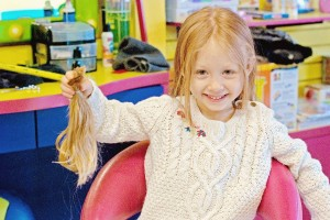 Little Kayla Furie turns her first haircut into something really special. PHOTOS / Furie family