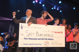 Steak Shapiro from 790 the Zone awards the $5,000 grand prize to overall winner Sam Burchfield. PHOTO / Eric Bern Studio