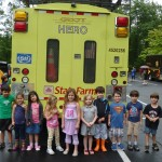 CBT preschoolers stand in front of a Georgia Department of Transportation HERO vehicle.