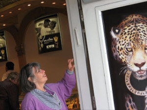 Wendy Feinberg reaches out to touch a mezuzah she spotted on the doorpost of a jewelry store in Ketchikan, Alaska. The owner of the shop is Jewish and places mezuzot at the entrances of all his stores. PHOTO / Ron Feinberg