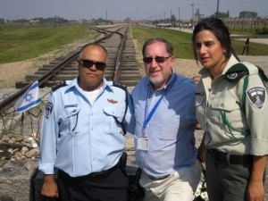 Rabbi Paul Kerbel of Congregation Etz Chaim in Marietta shares a moment with two Israeli officers during a recent trip to Eastern Europe.
