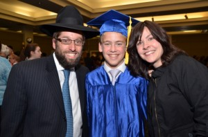 Rabbi Naphtali Estreicher (L-R), Moshe Yitzchak Estreicher and Rivkah Estreicher – father, son and mother, all Torah Day graduates. PHOTO / TDSA