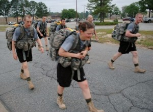 Rachels, lugging about a hefty backpack, trudges through a forced march during OCS training at Fort Benning.