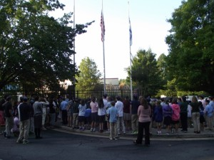Students gather around the flagpoles on the GHA campus during a special 9/11 ceremony earlier this month. PHOTO / GHA