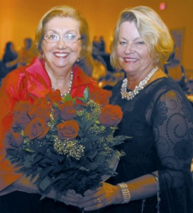 Yvonne Williams (right) president and CEO of the Perimeter Community Improvement District, congratulates Liane Levetan.