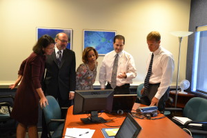 JF&CS CEO Gary Miller (second from left) and COO Rick Aranson (second from right) show off new Program Planning and Evaluation System software. PHOTO / JF&CS