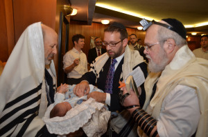 Rabbi Asher Yablok took a hands-on approach when bringing his son into the Covenant of Abraham.