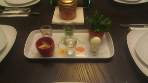 Our makeshift seder plate offered salt water, romaine lettuce, parsley, egg, charoset and a tinfoil shank bone.