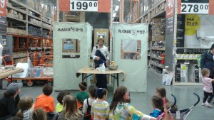 Friendly would-be farmer Shmuel Griesman explains the source of the flour used to make matzah during the JCrafts demonstration at Home Depot.
