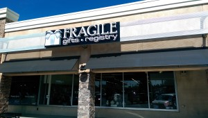 Fragile's new location in Sandy Springs Plaza gives the store access to the traffic Trader Joe's, Party City and other stores draw.