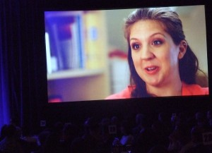 Ashley Semerenko, an onsite social worker at the Ben Massell Dental Clinic, discusses her work with clients in need on a video shown during the Community of Caring luncheon.