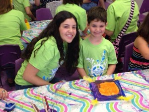 Volunteer Brooke, 16, and special-needs child Sammy, 5, participate in a Friendship Circle event.