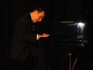 Richard Kogan practices the piano skills he refined at Juilliard. (photo by Kevin Madigan)