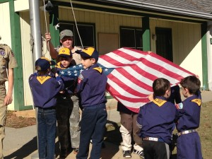 Cub Scouts in Pack 1818 tend to the American flag during a camping trip.