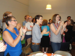 The enthusiasm of the Pride Seder crowd isn't hurt by a delayed start resulting from the big news June 26. (photo by Kevin Madigan)