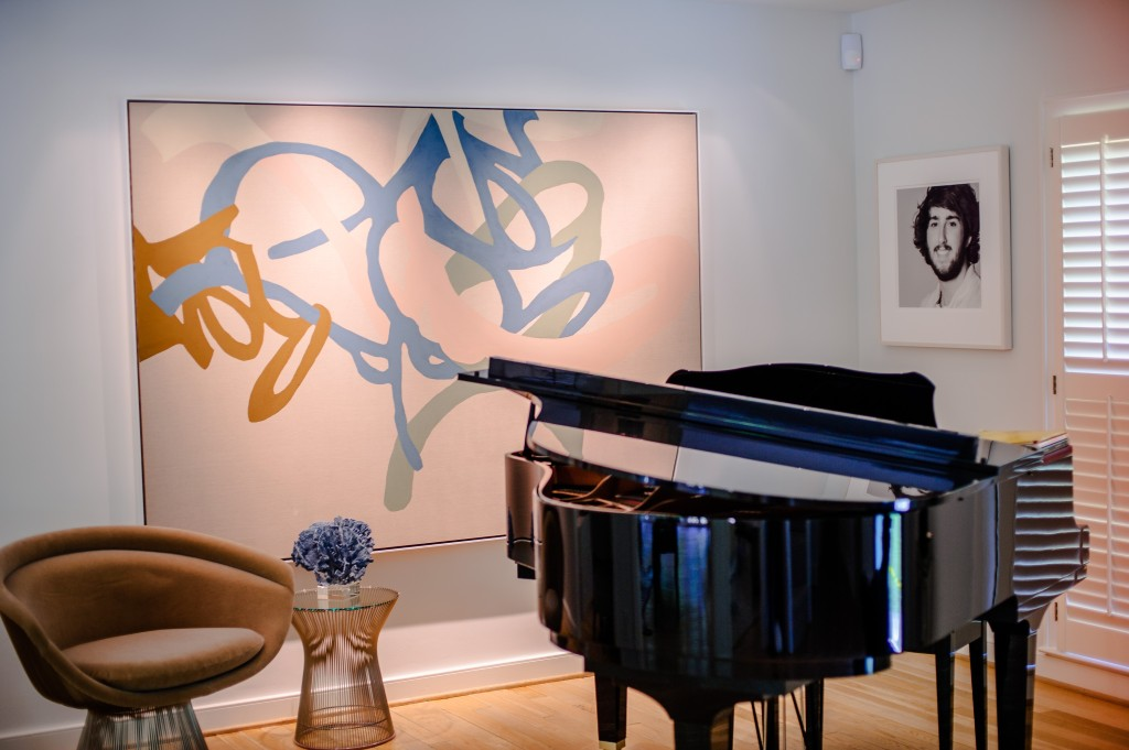A Carolyn Carr painting commissioned for the music room and a Platner for Knoll chair offset the piano in the music room.
