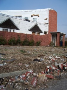 Four months after Hurricane Katrina, the abandoned Biloxi location of Congregation Beth Israel was still littered with the remnants of the brick façade. (Photo by Michael Jacobs)