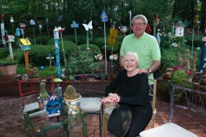 Photo by Duane Stork Sandy and Dave Abrams enjoy the hand-crafted metal chairs in their 70-piece back yard.