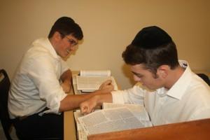 Seniors Naftali Mamane (left) and Yosef Levi Grossblatt study in the beis midrash.