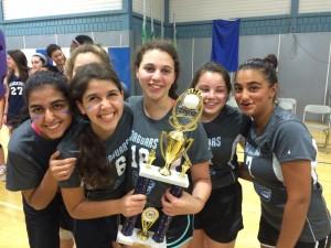 (From left) Helena Asherian, Eliana Goldin, Eliana Horwitz, Sela Ratner and Aliza Moosai hold the volleyball championship trophy.