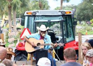 A singing cowboy entertains during a hayride across the back country.