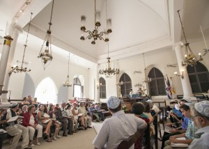 Friends and family pack the sandy-floored sanctuary on St. Thomas. (Photo courtesy Kelly Greer, photographer)
