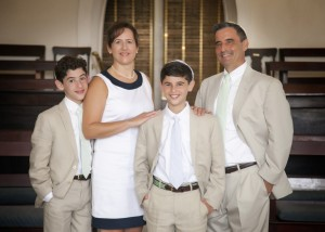 Bar mitzvah Sam Brenner is joined by parents Dara and Bob and brother J.J. (Photo courtesy Kelly Greer, photographer)
