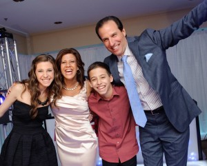The Danz family — Megan, Shelly, Ryan and Barry — makes sure to enjoy the party.