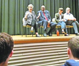 Sherry Frank addresses the Davis Academy students on a panel with the Rev. Gerald Durley, Christopher Moses and Rabbi Micah Lapidus.