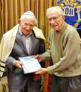 Sam Weinstein, 96, (left) receives his bar mitzvah certificate Friday, Nov. 13, from fellow Huntcliff Summit resident Sid Kojac, who was celebrating his 102nd birthday.