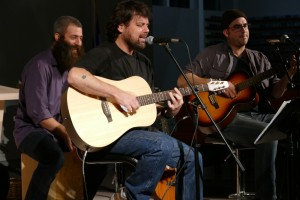 "Khen Rotem (center) and Ami Yares (right) perform songs from their album, named for the Grateful Dead's 1976 song ""Promised Land."" Drew Cohen joins in on the cajon."