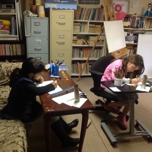Torah Day School students work on their art in Elena Oliker's basement studio.