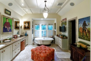 """The master bathroom is dedicated to the ladies, including a walk-in tub, Lorenzo Scott portraits and Linda Anderson's """"Eve in the Jungle."""""""