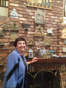 Doris Goldstein's brick wall displays only a portion of her roughly 45-piece chanukiah collection.