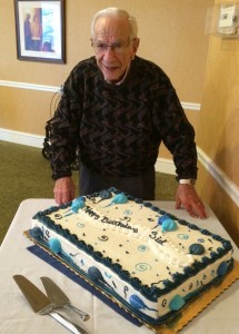 Sid Cojac checks out the cake for his 102nd birthday at Huntcliff Summit.