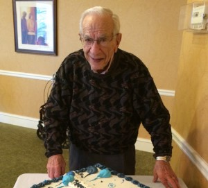 Sid Cojac poses with the cake during his 102nd birthday at Huntcliff Summit.
