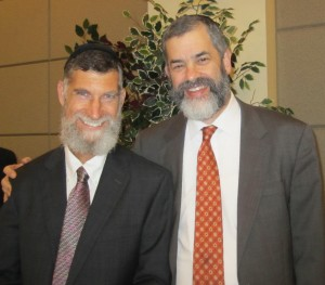 Rabbi Ilan Feldman (right) welcomes Rabbi Hanoch Teller to Congregation Beth Jacob on Dec.1.