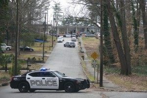 Doraville police establish a perimeter around the AJA Upper School the morning of Jan. 26 while the DeKalb County bomb squad sweeps the building and searches for explosive devices. (Photo by David R. Cohen)