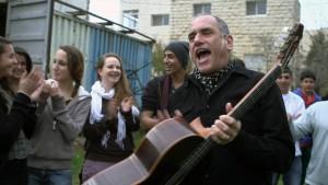David Broza sings with the Jerusalem YMCA youth choir in a scene from East Jerusalem West Jerusalem