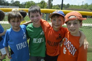 (From left) Ethan B., Avi S., Ben R. and Ryan C. are ready for soccer last summer at Zaban Park.