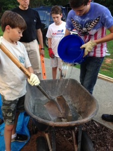 Fellow Boy Scouts help create the concrete Star of David for the project at Congregation B'nai Israel.