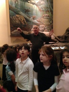 Alan Feingold explains to Torah Day second-grade girls what's happening in the beehive at the Fernbank Science Center.