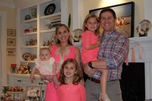 Stacey and Mark Rothberg pose with their three daughters.