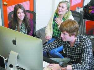 Charli Shapiro (left) edits films she created at Camp Flix.