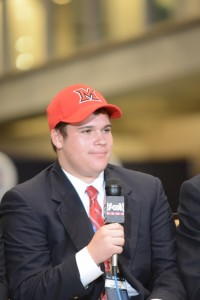 Samuel Sloman sports the hate of his college choice, Miami University.