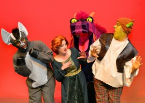 """Photo by Jennifer Bienstock """"Shrek the Musical, Jr."""" features (from left) Jared Brodie as Donkey, Margaret Whitley as Princess Fiona, Bess Winebarger as Dragon and Luke Davis as Shrek."""