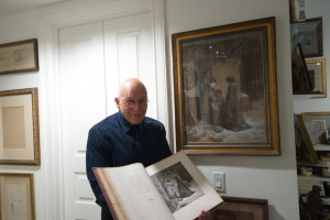 Michael Schlossberg compares his rare Doré first edition to a drawing of Fontaine's first fable. The Schlossbergs house over 4,000 books in their library.
